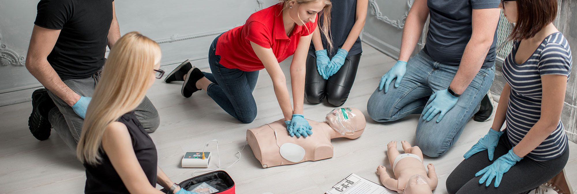group of people learning CPR