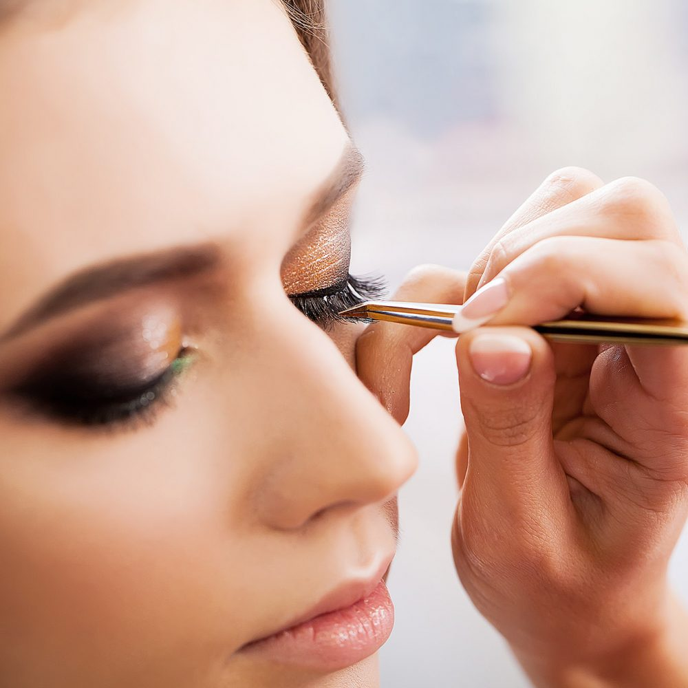photo of a woman getting her eye makeup done