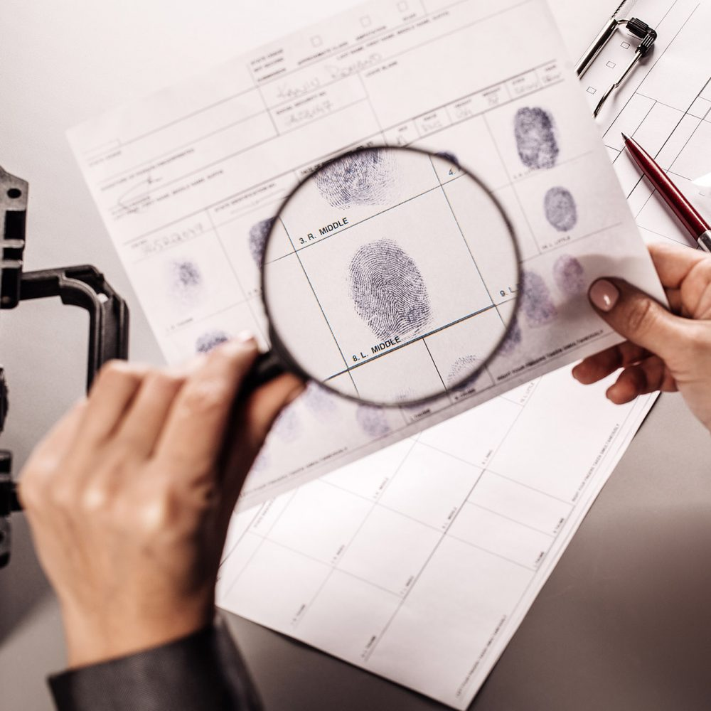 photo of woman inspecting fingerprints