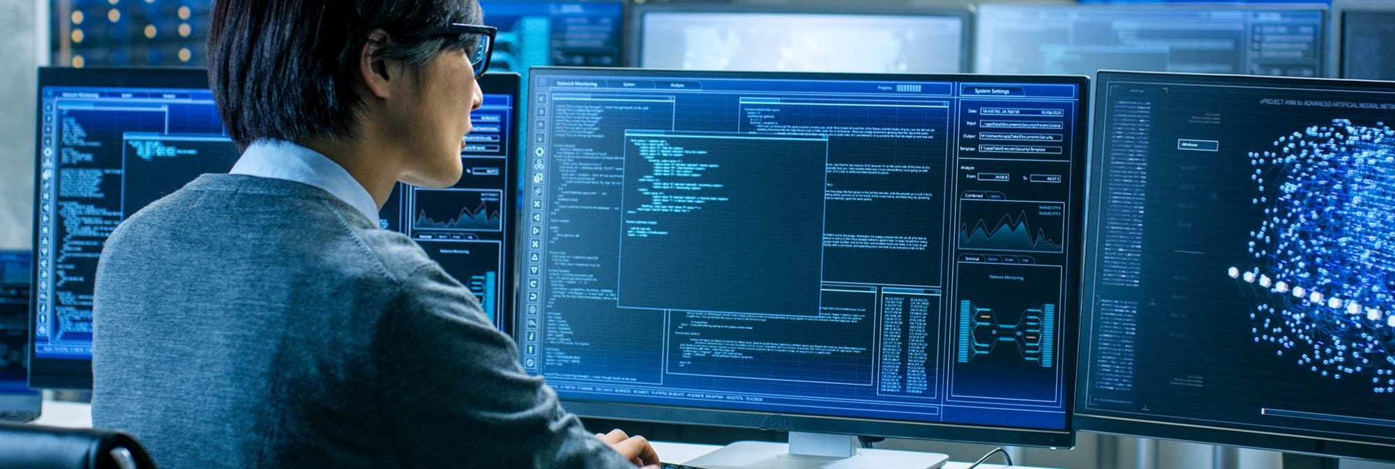 picture of a young man doing network security on computers