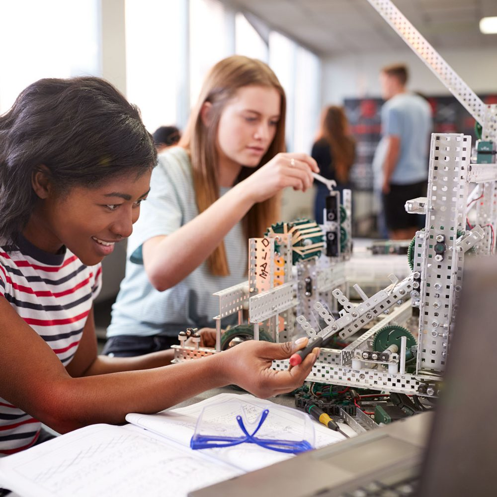 teen girls building in their pre-engineering class