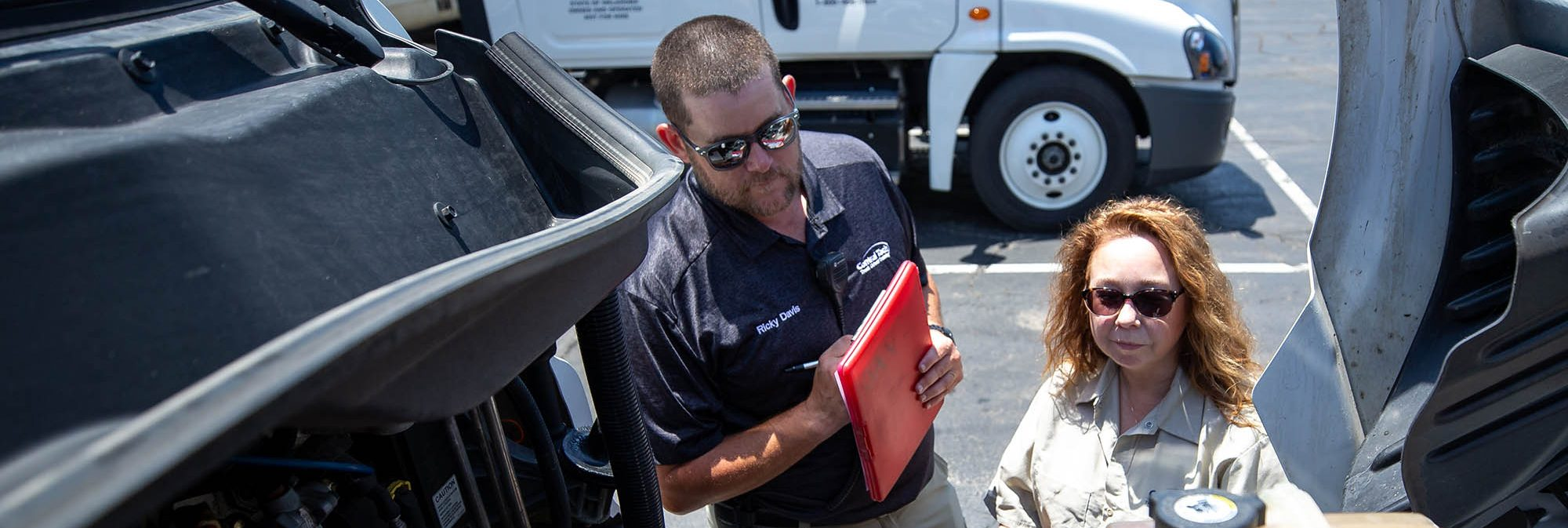 Central Tech instructor checking a semi truck with a student