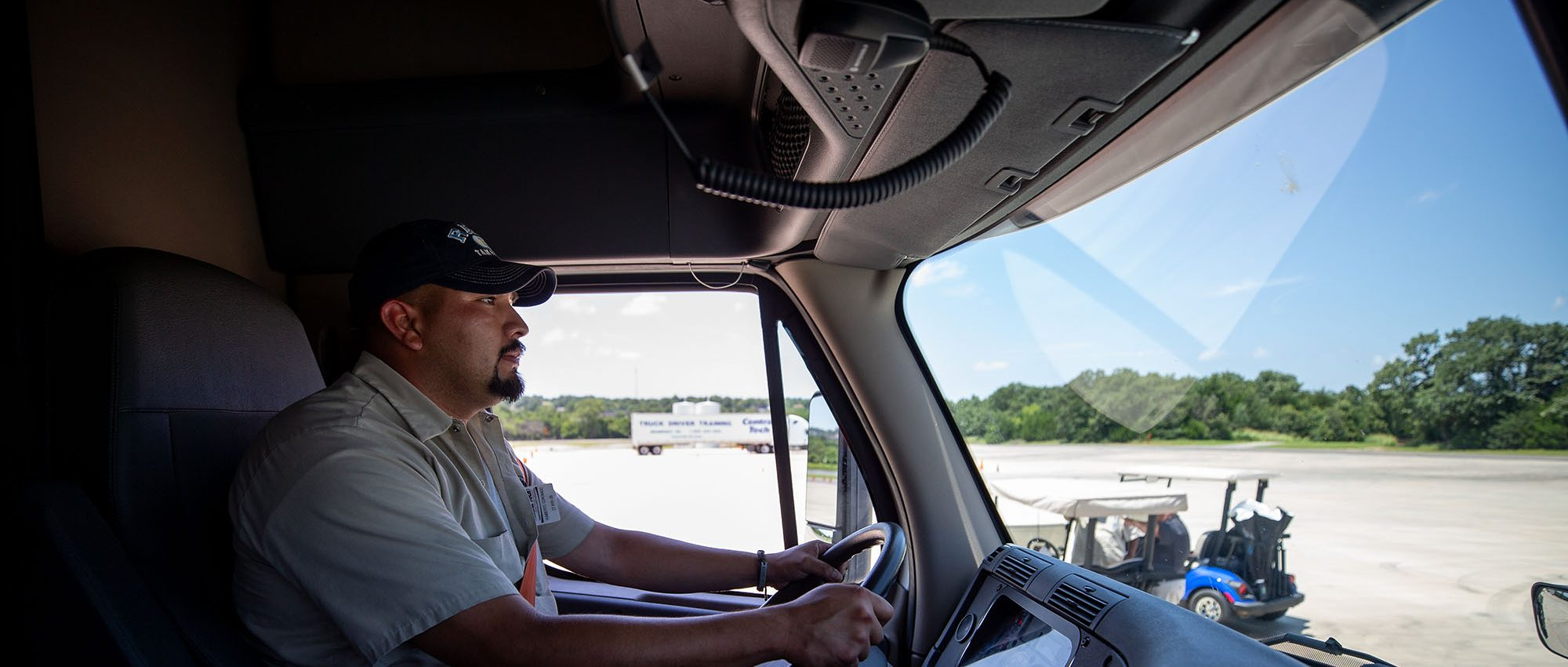 photo of a man driving a Central Tech semi truck