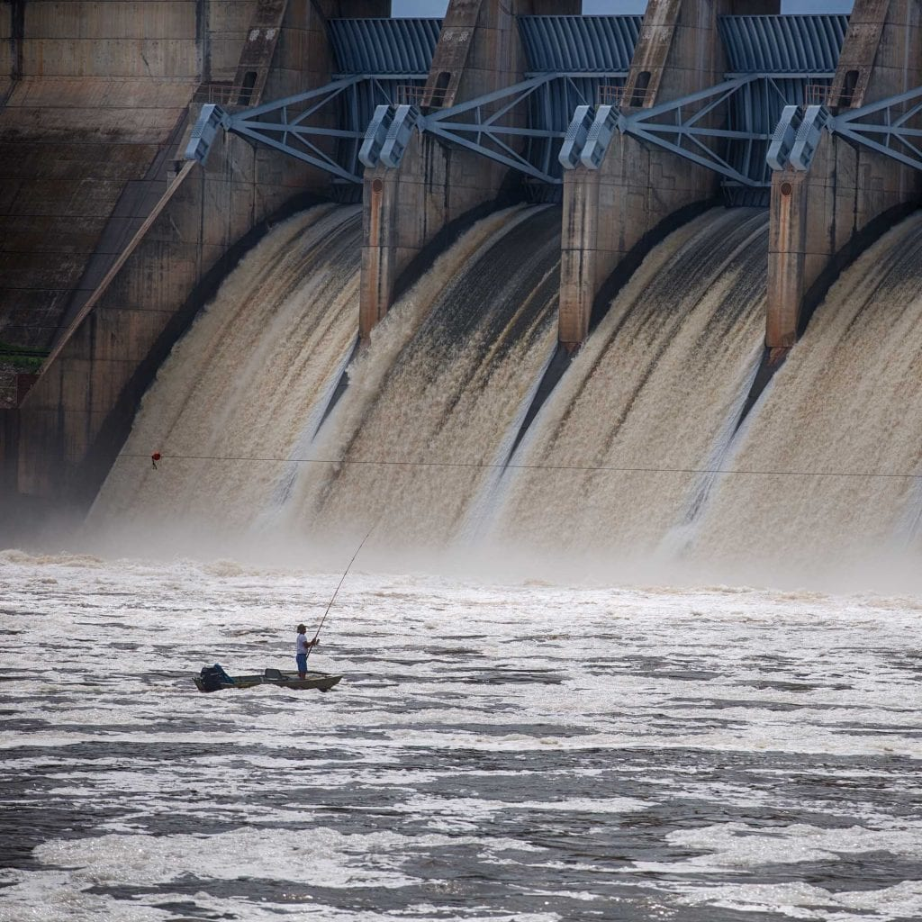 photo of a man fishing by the Keystone Dam in Mannford Oklahoma