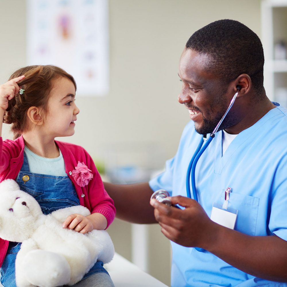photo of a medical assistant with a pediatric patient