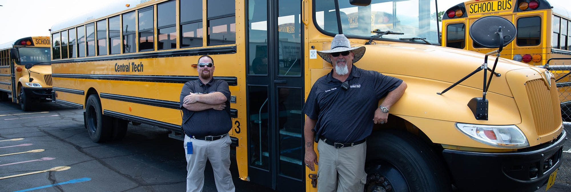 photo of two CDL instructors by a school bus at Central Tech in Oklahoma