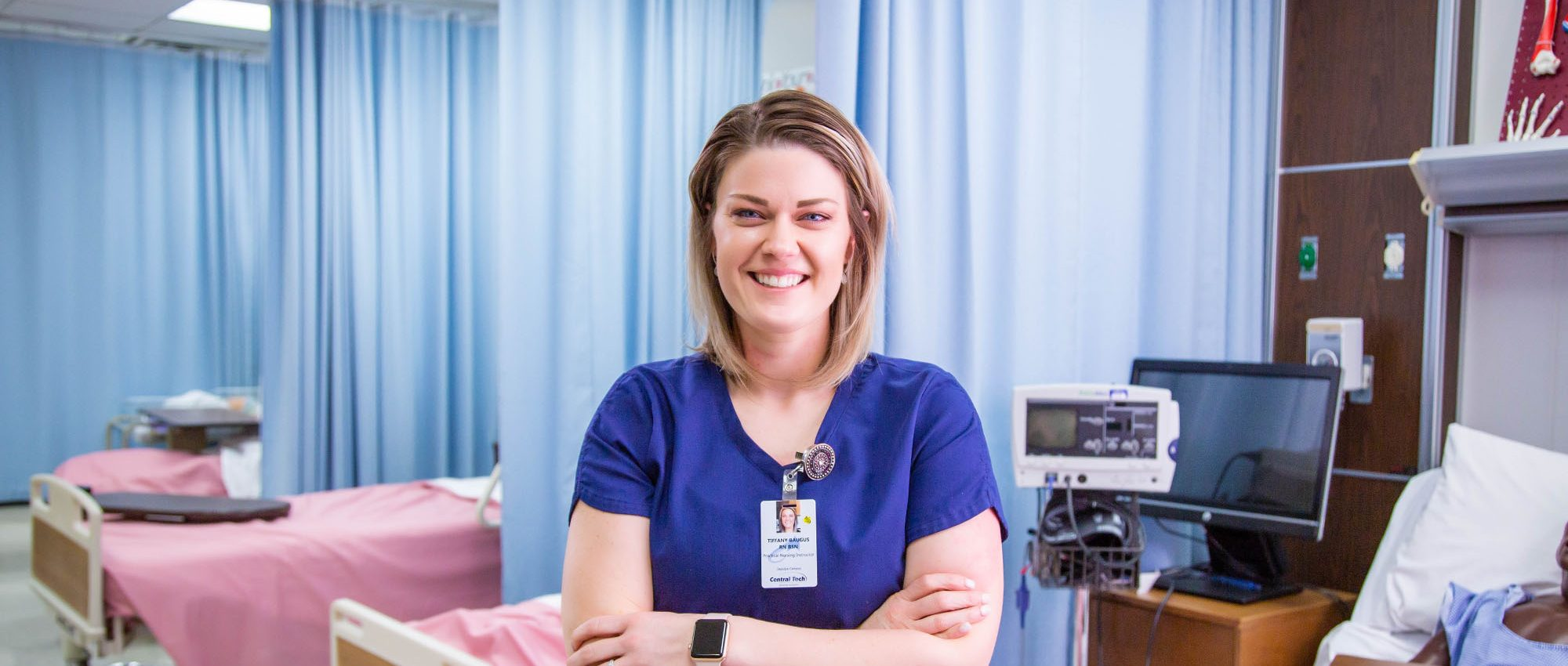 picture of a health nurse by hospital beds