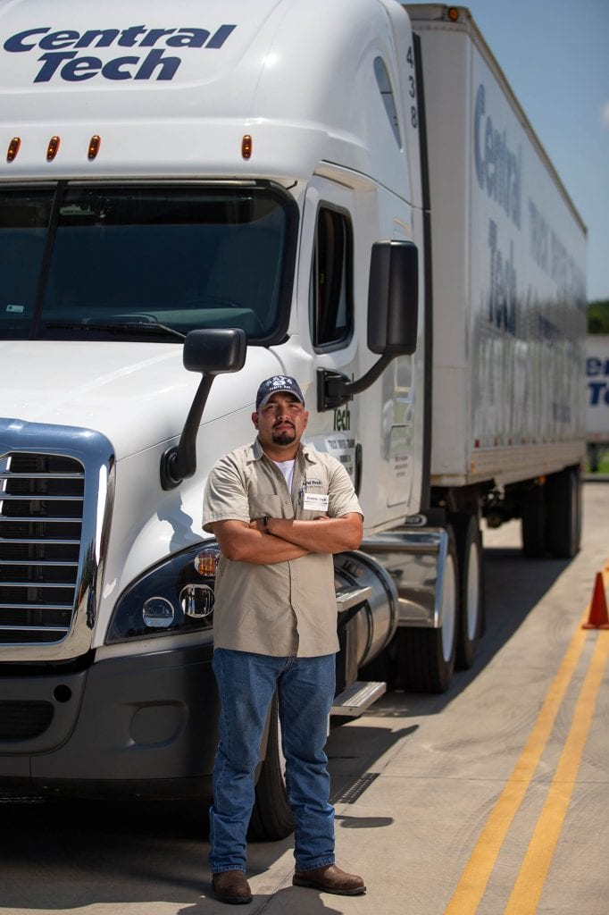 picture of a man with his CDL license by a Central Tech semi truck