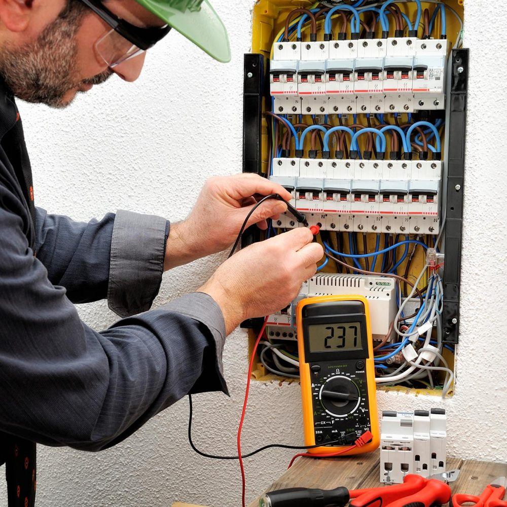 picture of a man working on an electrical breaker
