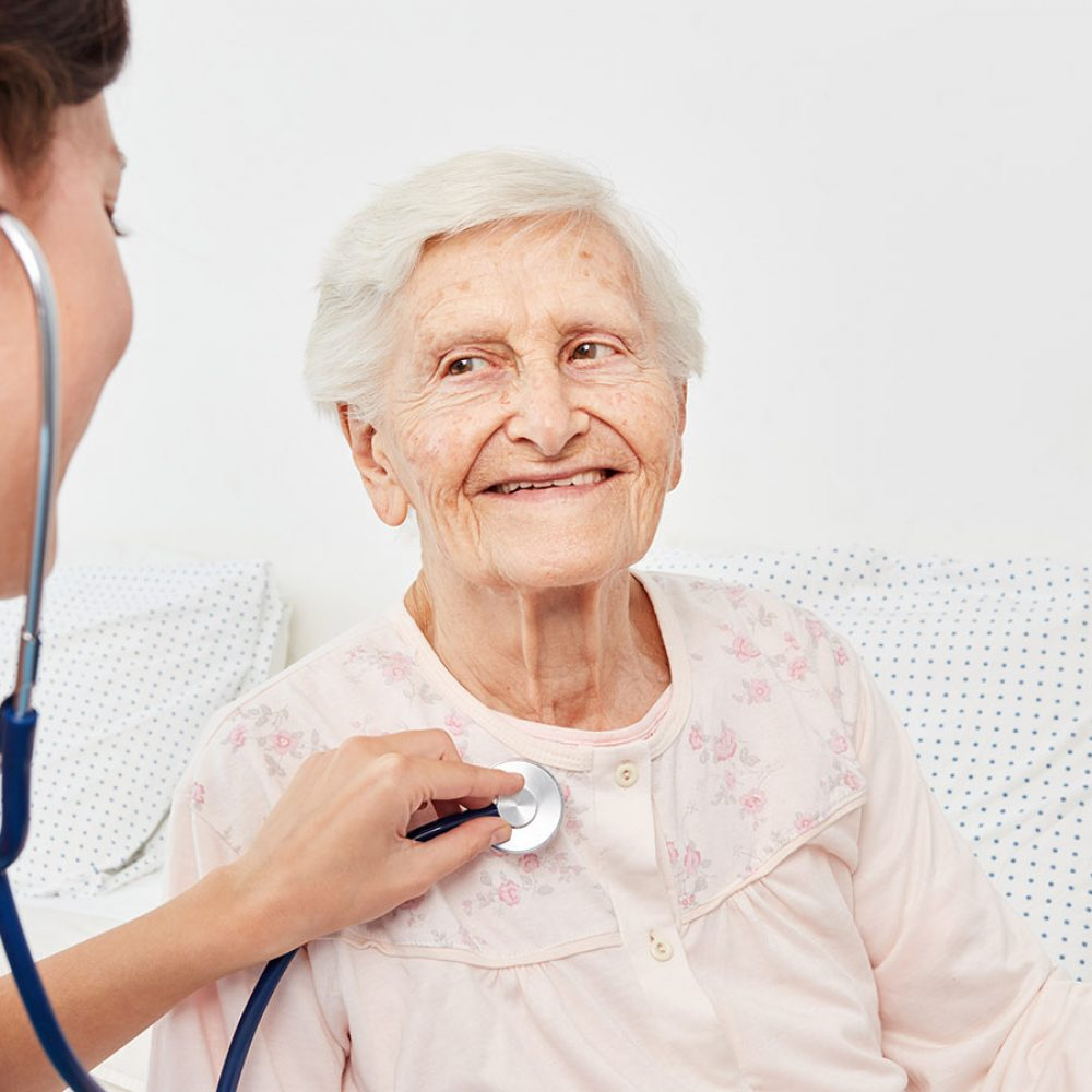 picture of a nurse listening to a womans lungs