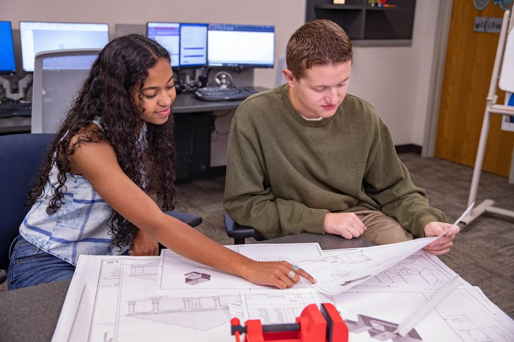 Central Tech Drafting students reviewing blueprints