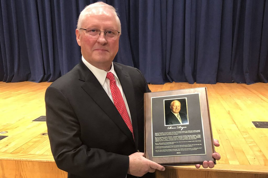 Ron Dyer holding his Drumright Hall Of Fame award