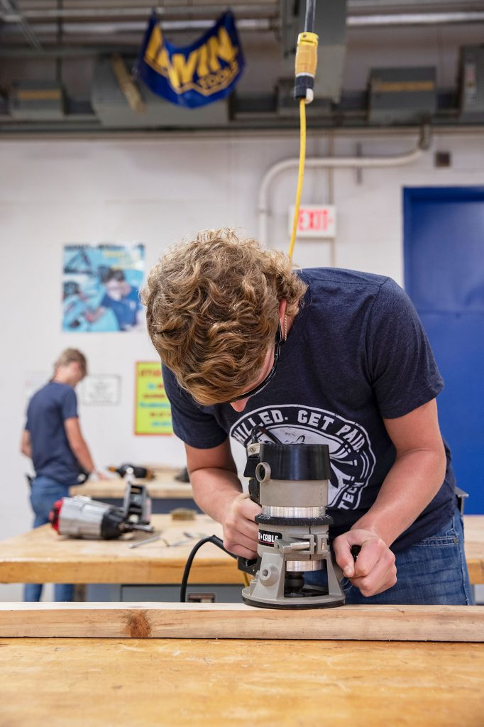 construction student using a router at Central Tech Drumright
