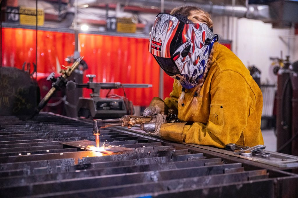 female welding student at Central Tech