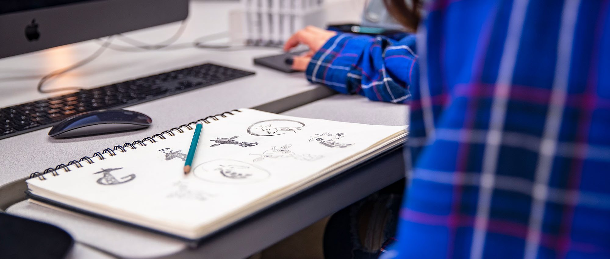 graphic design student studying logo drawings